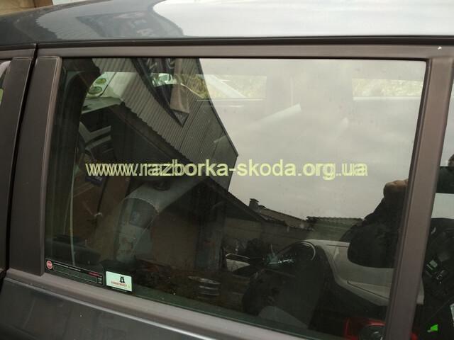 Стекло задней левой двери б/у Skoda Fabia New